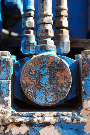 Industrial machinery detail. Rusty metal texture with peeled paint. Stock Photo - 1980080