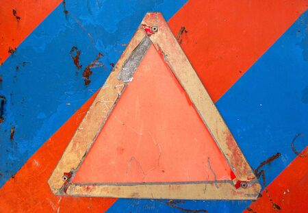 Weathered warning sign against an industrial metal surface. Scratched paint and rust background. Place your own text. Stock Photo