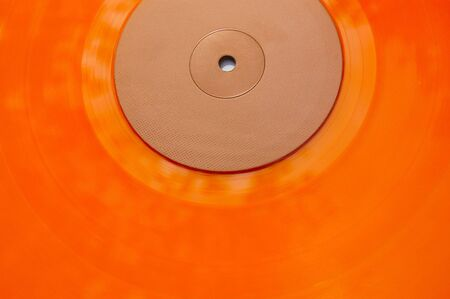 Colored orange vinyl record texture. Abstract background. Stock Photo - 2059704
