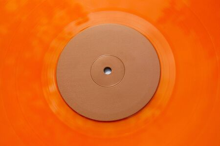 Colored orange vinyl record detail. Abstract background. Stock Photo - 2059705