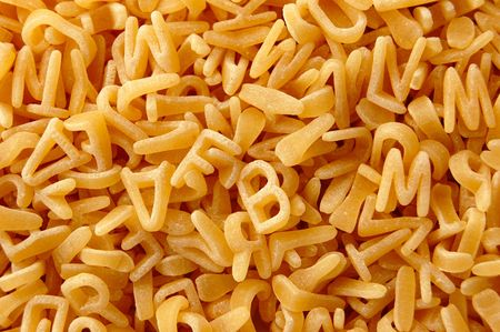 Kids soup letters pasta. Italian food background. photo