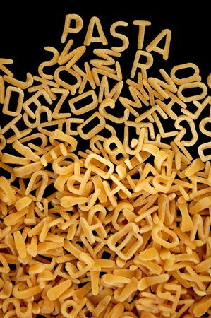 Spelling of the word pasta with alphabet soup letters.