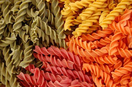 Four different flavors of fusilli twirls pasta. Italian food background detail. Stock Photo - 2220211