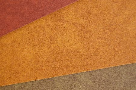 Three different colors of recycled paper. Speckled cardboard background texture. photo
