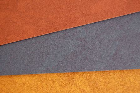 Different colors of recycled paper. Speckled cardboard background texture. photo