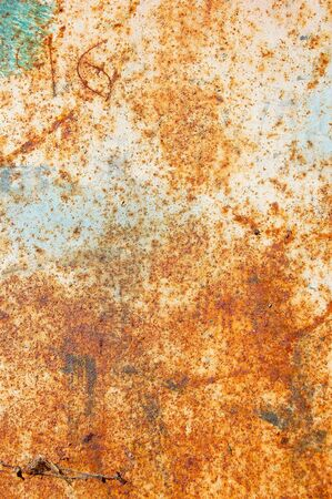 Rusty metal with peeled paint and etched numbers. Abstract background texture. photo