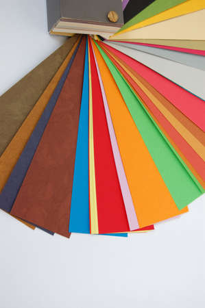Paper color guide background. Different weights and colors of printing paper. photo
