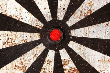 Abstract background. Old dartboard target and rusty metal texture.