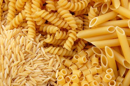 Four different kinds of pasta. Italian food background. Stock Photo - 3322669