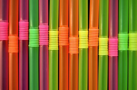 Drinking straws against a black background. Abstract pattern. Stock Photo - 3469190