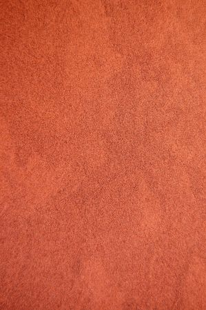 Dark brown recycled speckled cardboard paper detail. Background texture. photo