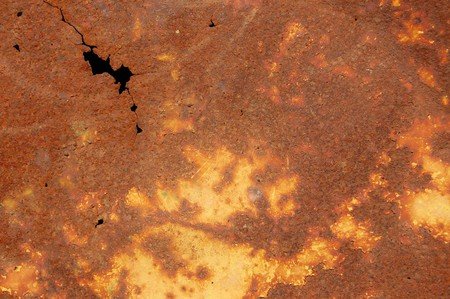 Cracked rusty metal sheet texture. Abstract industrial background. photo