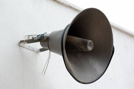 Weathered public announcement loudspeaker on white wall. Stock Photo - 4911204