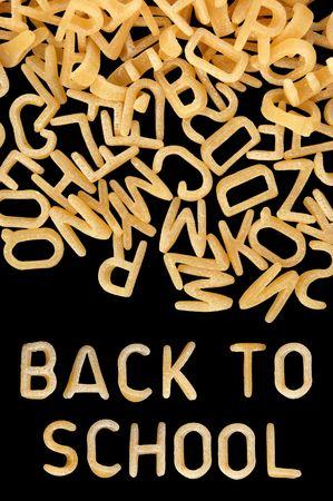 Back to school written in kids alphabet soup pasta. Stock Photo - 5379518