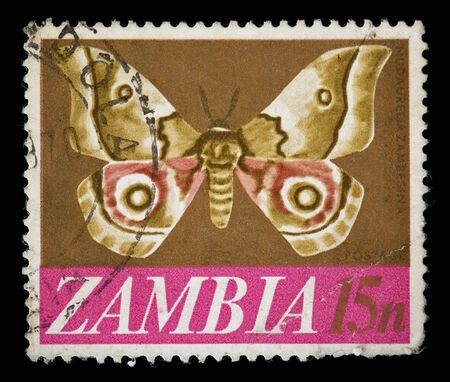 canceled: Vintage republic of Zambia postage stamp with butterfly illustration. Stock Photo