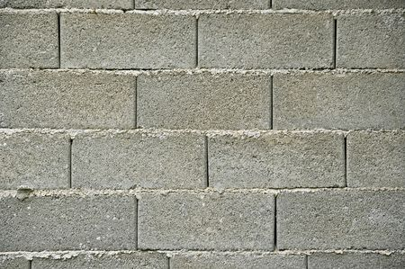 Cinder block rough wall texture background pattern.