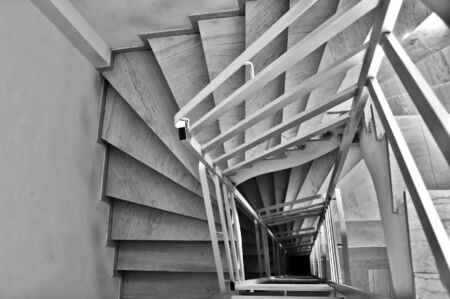 concrete stairs: Interior staircase architecture background. Black and white. Stock Photo