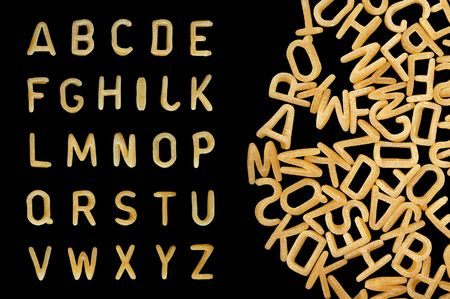 Alphabet soup pasta font. Letters made from kids food. Stock Photo