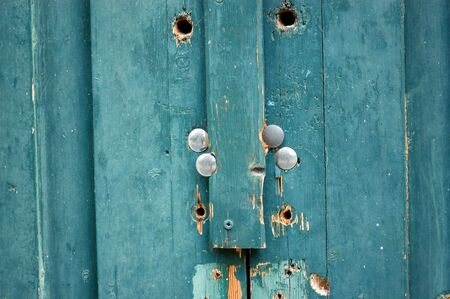 Vintage wooden blue door macro. Weathered wood background texture. photo