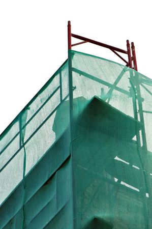 scaffolds: Debris netting and scaffold at construction site. Stock Photo