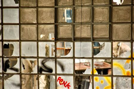Broken windows in a partially demolished abandoned factory. Stock Photo - 6062329