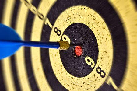 Dartboard target and dart arrow. Selective focus. photo