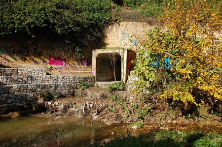 Waste water and sludge from a drain contaminating a small river. Stock Photo - 6249832