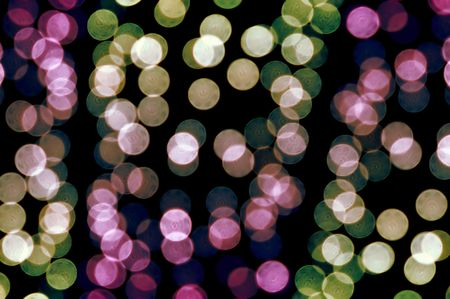 Out of focus colorful light dots. Abstract background. photo