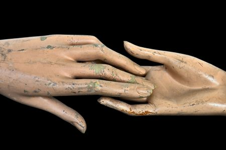 Weathered hands of plastic mannequin doll.