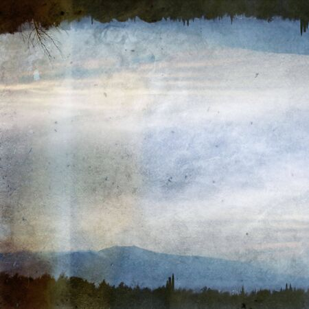 dissolving: Double printed vintage discolorated photograph of trees, distant city lights and mountain horizon. Abstract illustration.
