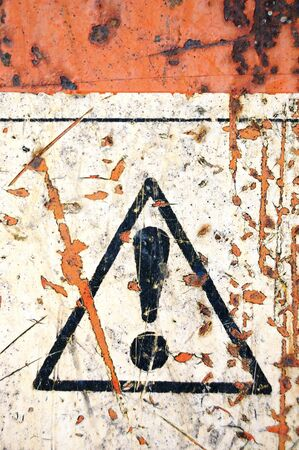 Weathered warning sign on rusty metal surface. Stock Photo - 7714785