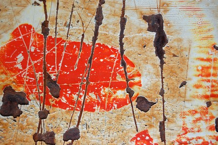 Rusty metal surface with scratched paint stains. photo