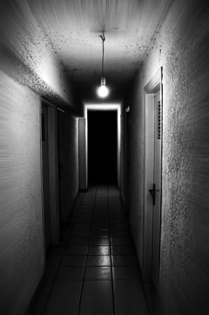 gloomy: Light shining in dark basement corridor. Motion blur. Stock Photo