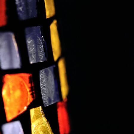 Colorful stained glass abstract shapes background. Selective focus. photo