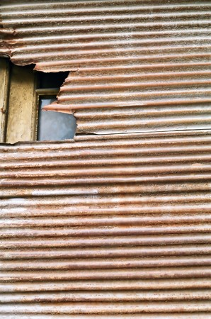 Weathered rusty roll down corrugated metal shutter texture. Stock Photo - 8228619