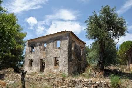 deteriorating: Traditional rural house in Zakynthos abandoned after a severe earthquake in 1953.