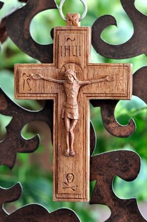 Wooden crucifix and rusty metal pattern background. photo
