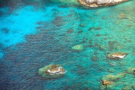 Crystal clear blue sea water at rocky beach in Zakynthos, Greece. Stock Photo - 8597186