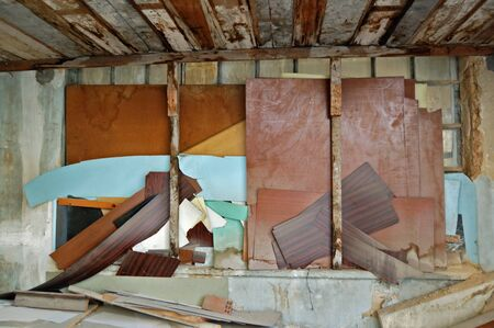 Window boarded up with broken wood planks. Abandoned factory interior. Stock Photo - 8735347