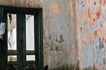 Burned house interior. Vacant room charred door and textured wall. Stock Photo - 8735471