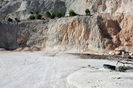 Deserted landscape of a mountain quarry site. photo