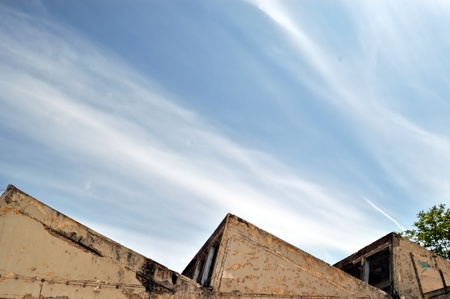 Partially demolished abandoned factory exter and cloudy sky. Stock Photo - 8735345
