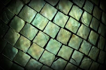 Stained broken glass squares texture macro. Abstract background selective focus. photo