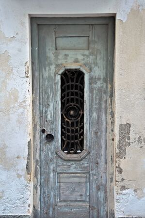 Weathered derelict house wooden door. Vintage metalwork pattern. Stock Photo - 8735476