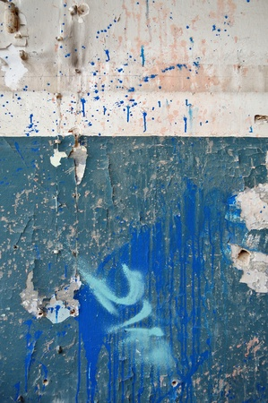 Weathered peeling wall surface with messy splashed paint. Abstract background. Stock Photo - 8735473