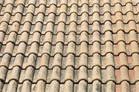 Ceramic roof tiles abstract background. photo