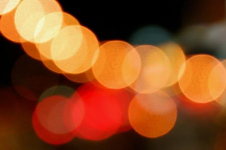 Out of focus city traffic lights at night. Abstract background. Stock Photo