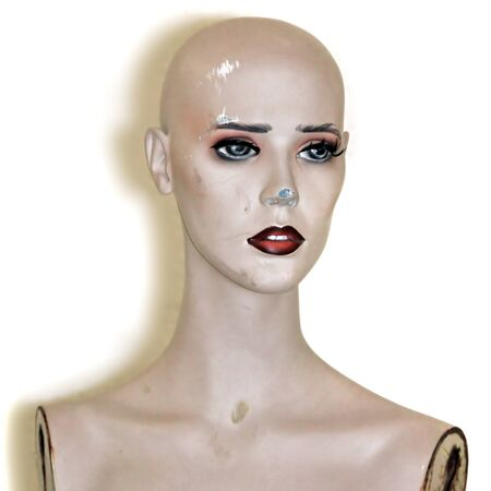 Weathered plastic mannequin doll head on white background.