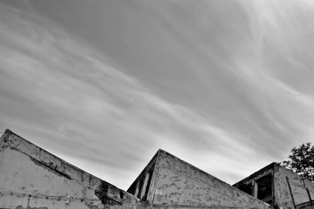 Abandoned factory roof and cloudy sky. Black and white. Stock Photo - 8904799