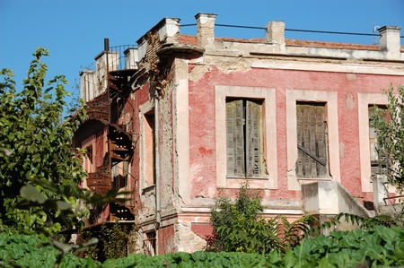 Overgrown plants in the garden of an abandoned neoclassical house. Stock Photo - 8953258